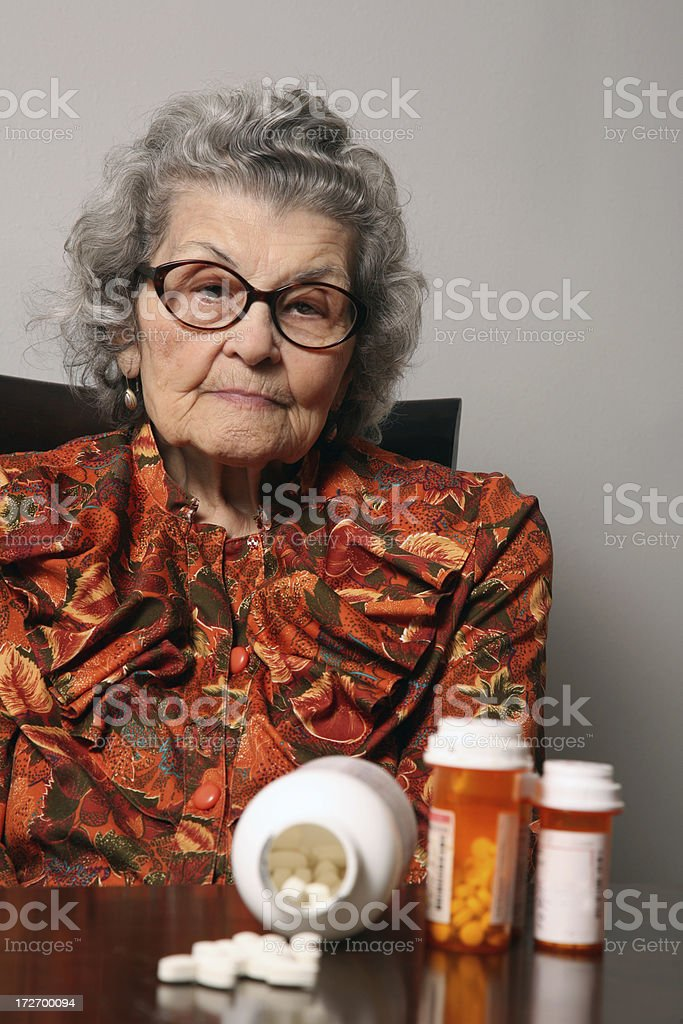 Senior Woman concerned about Prescription Medicine and Healthcare royalty-free stock photo