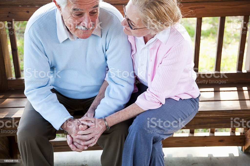 Senior woman consoling sad husband. royalty-free stock photo