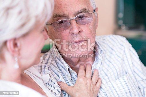 istock Senior woman consoling sad husband, Sad Senior Couple, pensioner 539218344