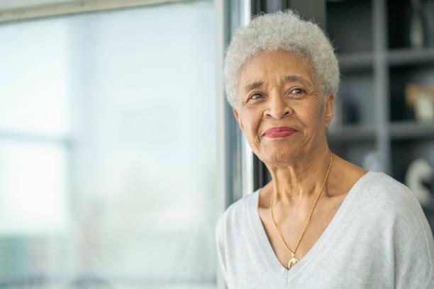 Senior woman contemplates stock photo