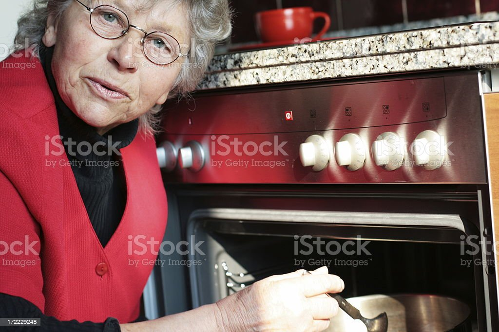 Senior woman cooking royalty-free stock photo