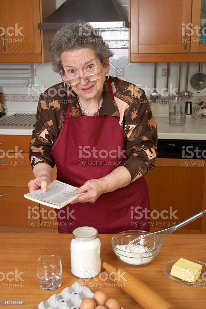 Senior woman cooking. royalty-free stock photo