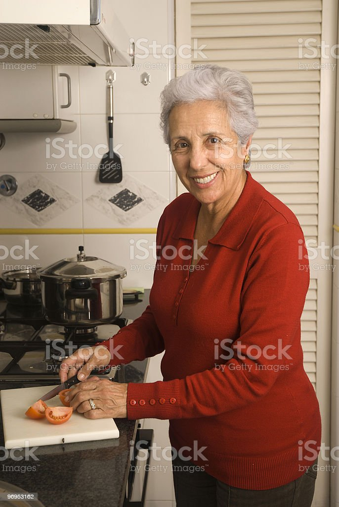 Senior woman cooking royalty-free stock photo