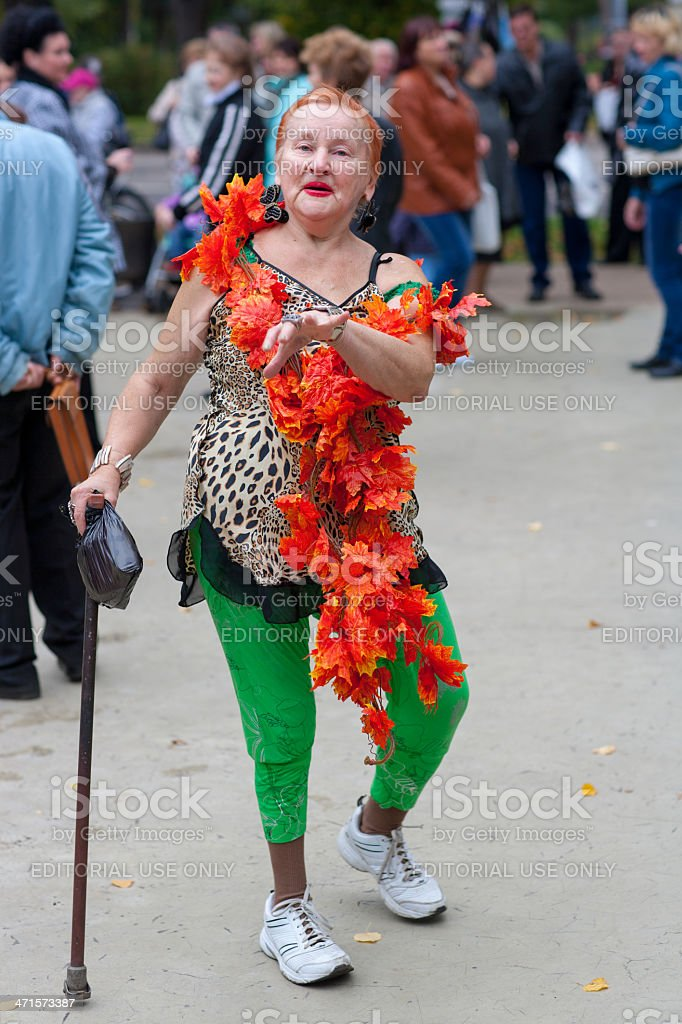 Senior woman dancing at a local daytime discotheque stock photo