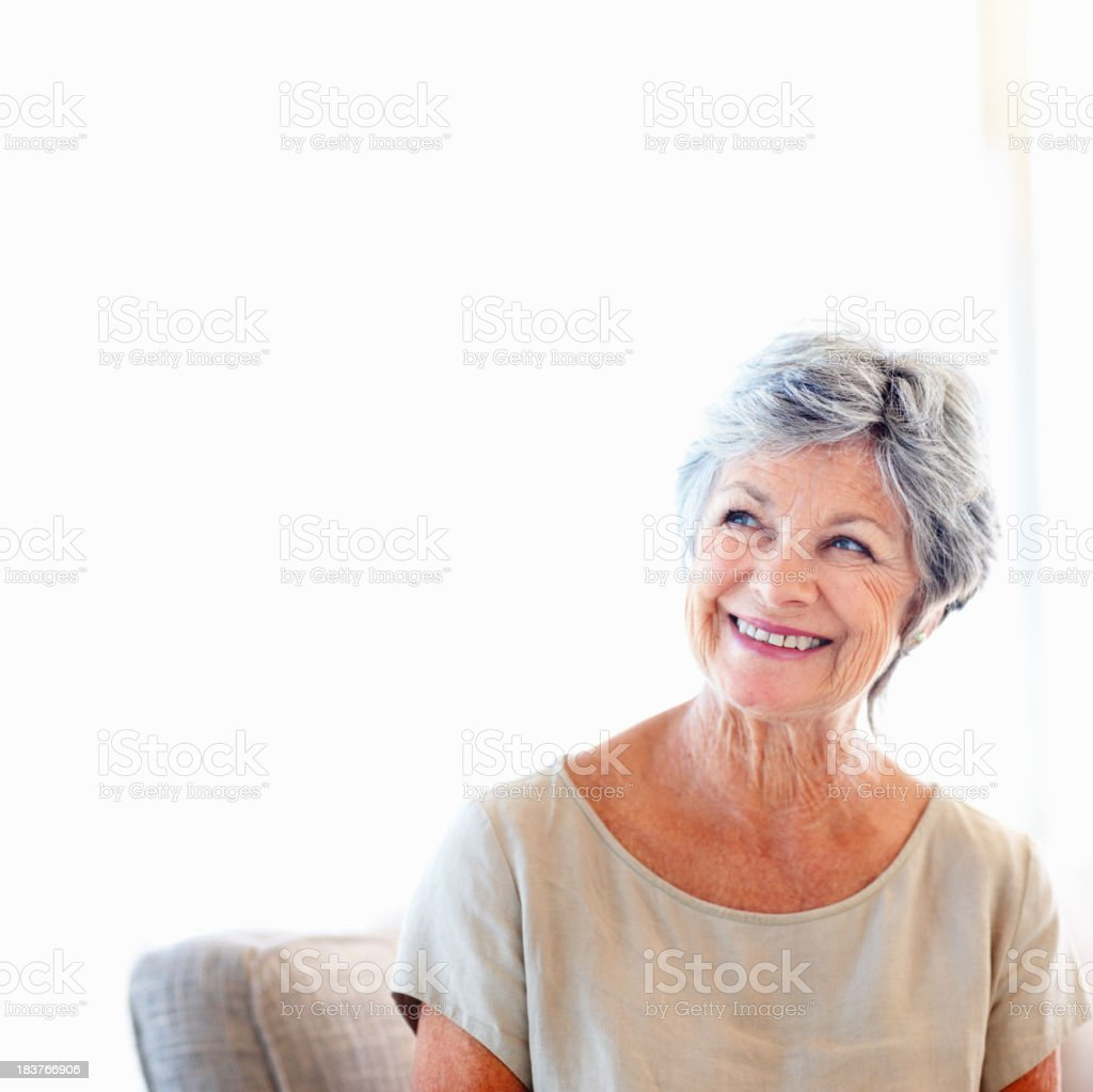 Senior woman day dreaming royalty-free stock photo