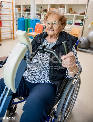 912333752 istock photo Senior Woman Doing a Physiotherapy Exercise in Retirement Home 871901544