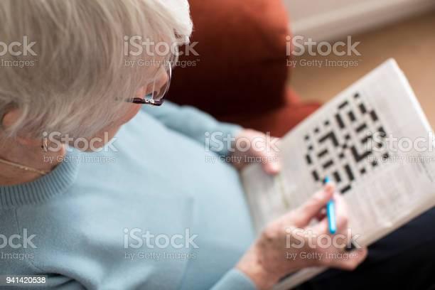 Senior woman doing crossword puzzle at home picture id941420538?b=1&k=6&m=941420538&s=612x612&h=0zqsze6dipi6c4yz0ofiuwoeiwwyt8yftayibtilklu=