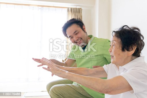 istock Senior woman doing exercise with physical therapist 1153775485