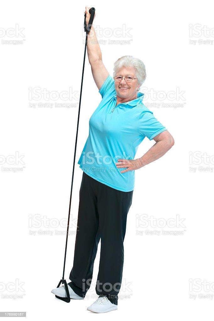 A senior woman doing exercises royalty-free stock photo