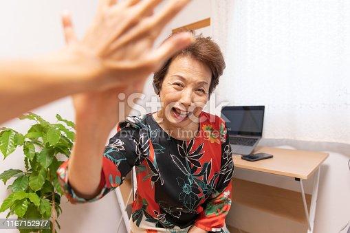 1031394114istockphoto Senior woman doing high-five 1167152977