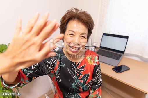 1031394114istockphoto Senior woman doing high-five 1167153192