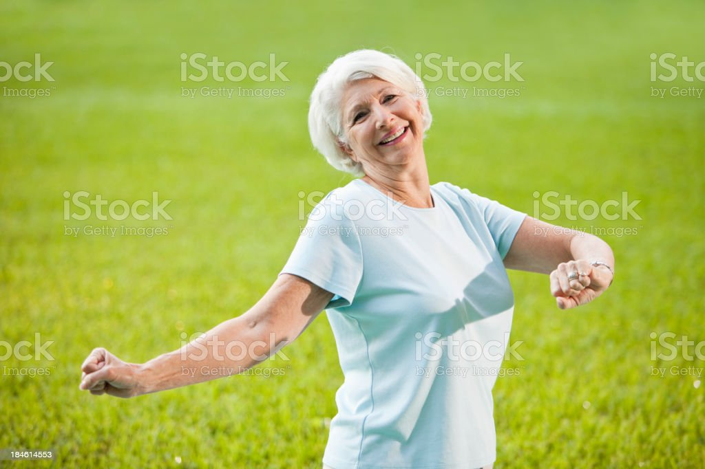 Senior woman doing stretching exercises stock photo
