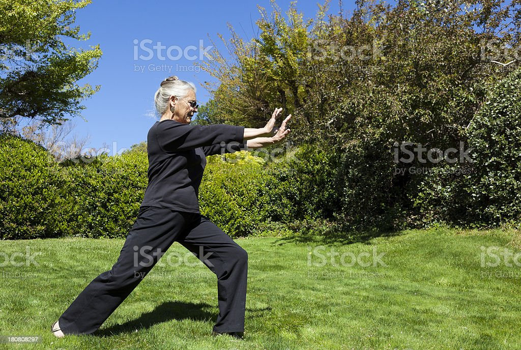 senior woman doing Tai Chi royalty-free stock photo