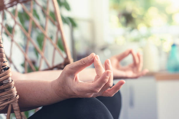 Senior woman doing yoga at home. stock photo