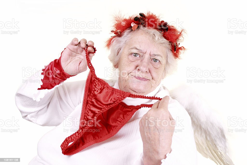 Senior Woman Dressed as Cupid and Holding Panties Up stock photo