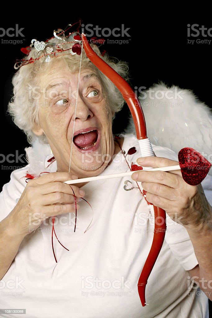 Senior Woman Dressed as Cupid with Bow and Arrow royalty-free stock photo