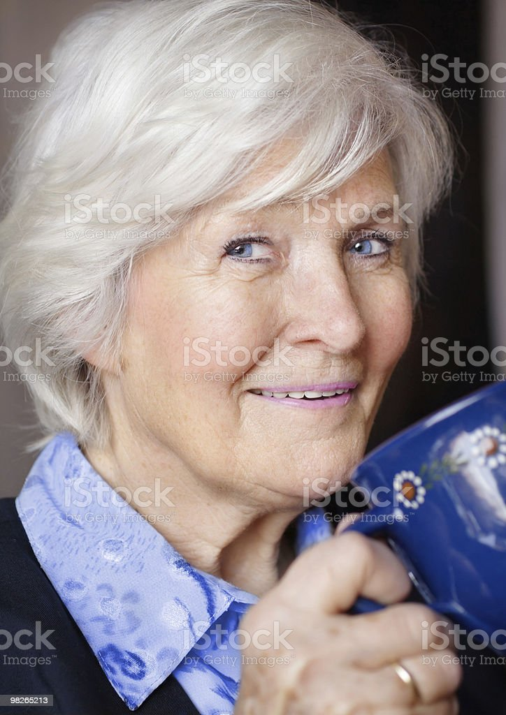 Senior woman drinking coffee royalty-free stock photo