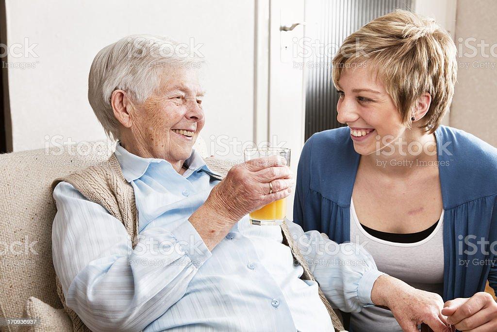 senior woman drinking orange juice royalty-free stock photo