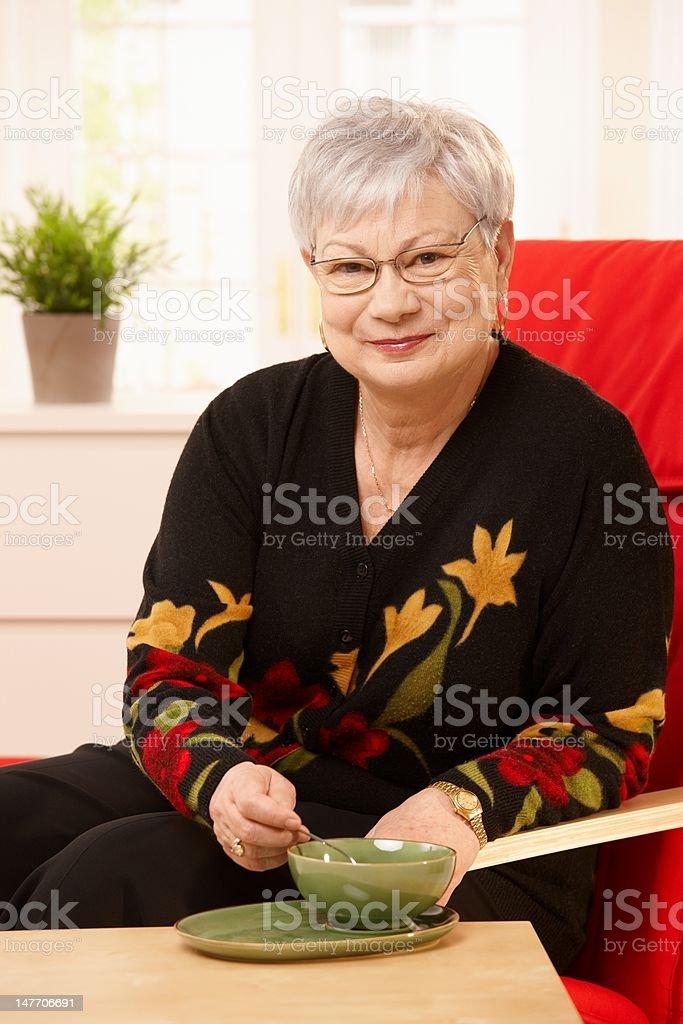 Senior woman drinking tea royalty-free stock photo