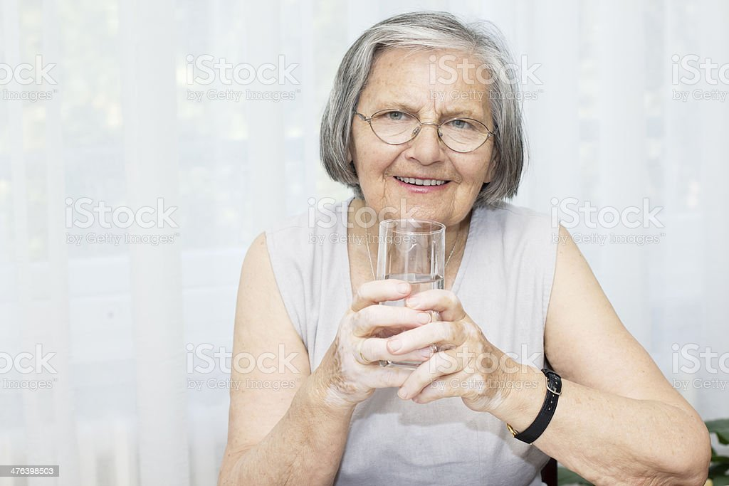 Senior woman drinking water royalty-free stock photo