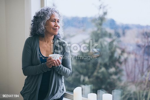 istock A Senior Ethnic Woman Drinks Tea While Contemplating the Day Ahead 902441194