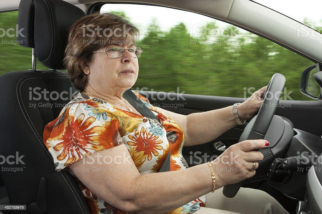 Senior Woman Driving a Car royalty-free stock photo