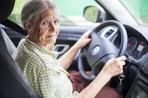 Senior woman driving a car stock photo