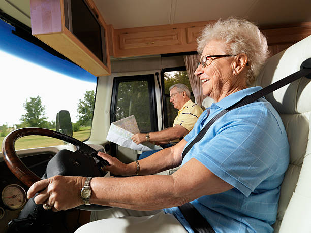 Senior woman driving RV. stock photo