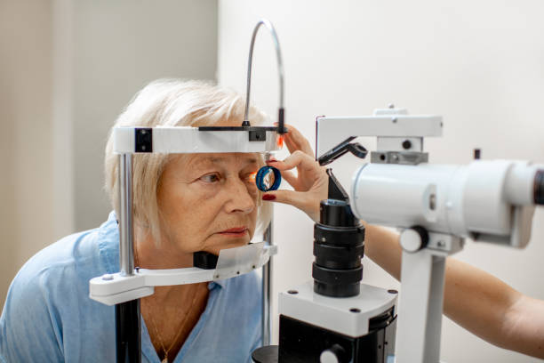 Senior woman during a medical eye examination stock photo