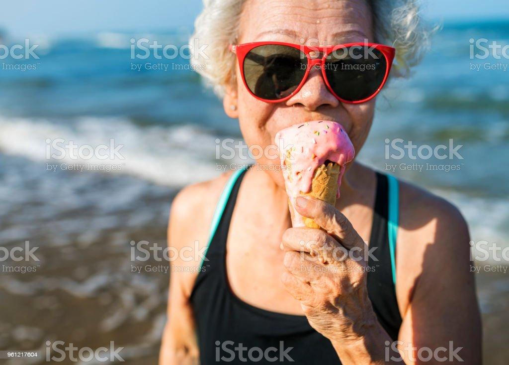 Senior woman eating an ice-cream stock photo