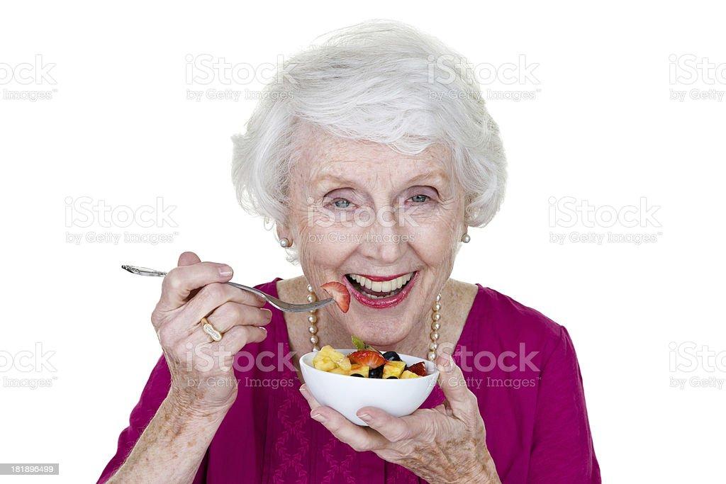 Senior woman eating fruit royalty-free stock photo