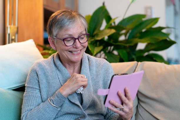 senior woman engaged in telehealth - telemedicine stock pictures, royalty-free photos & images