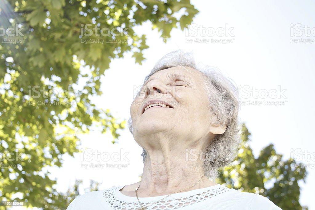 Senior woman enjoyes life royalty-free stock photo