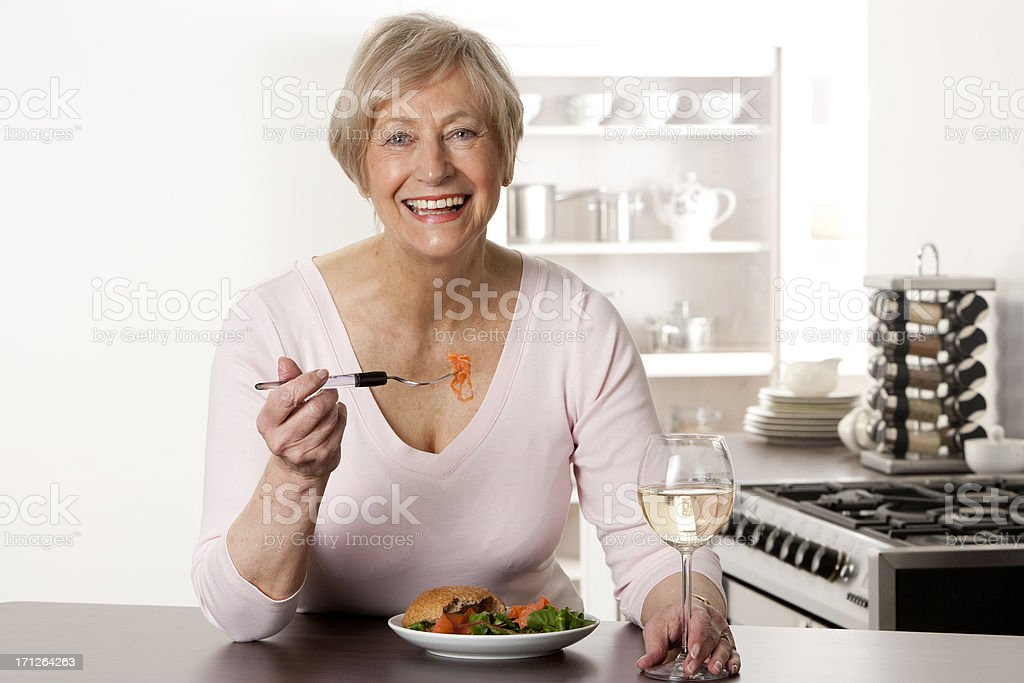 Senior Woman Enjoying a Meal stock photo