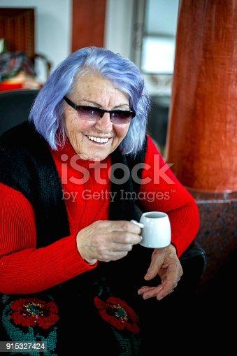 Senior woman enjoying cup of tea at home