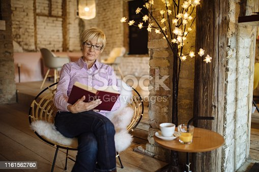 Senior woman enjoying reading a book