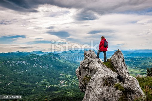 Senior woman in the mountains looking at the view, Slovenia, Europe. All logos removed. NIKON D3X, 24.0-70.0 mm f/2.8.