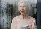 istock Senior Woman Enjoying The Rain 840846354