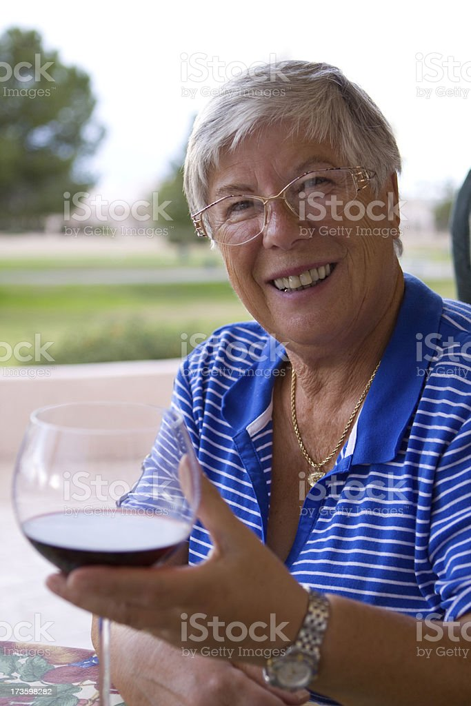 Senior woman enjoying wine stock photo
