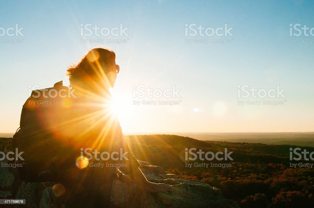 Senior Woman Enjoys Scenic Hike Mountain View Sunset Catskill Mountains stock photo