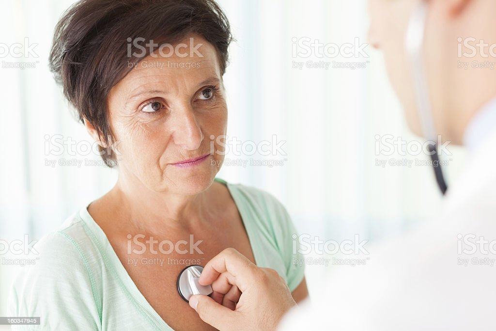 Senior woman examined by a doctor stock photo
