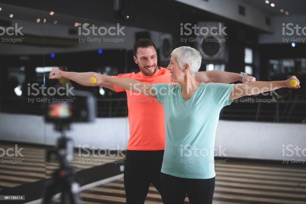 Senior woman exercising at the gym stock photo