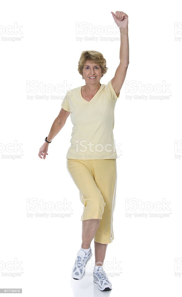 Senior woman exercising by marching royalty-free stock photo