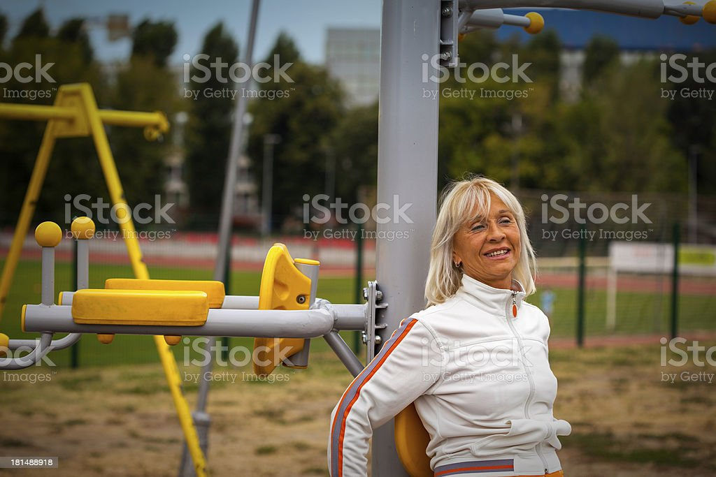 senior woman exercising in outdoor fitness center royalty-free stock photo