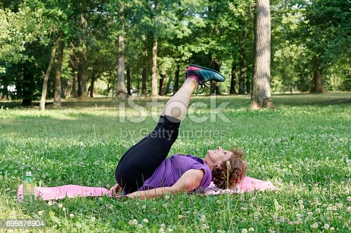 istock Senior woman exercising in the park 699878904