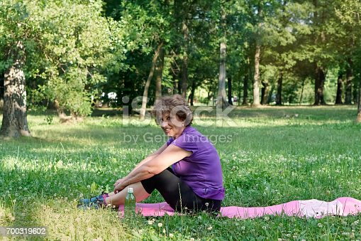 istock Senior woman exercising in the park 700319602