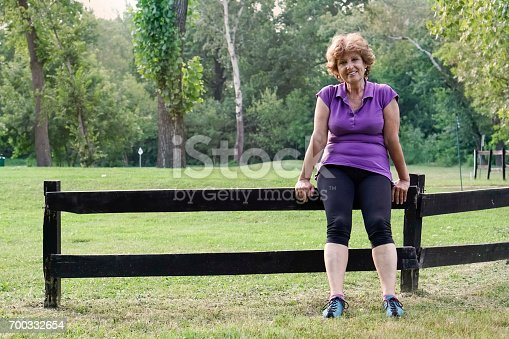 istock Senior woman exercising in the park 700332654