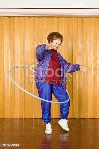 istock Senior woman exercising with a hula hoop 537665593