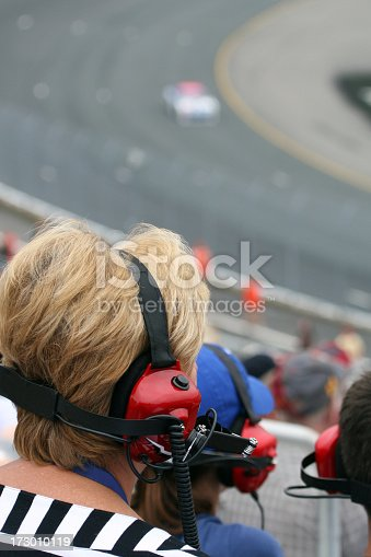 173015172 istock photo Senior Woman Fan at Racing Event and Looking at Race 173010119