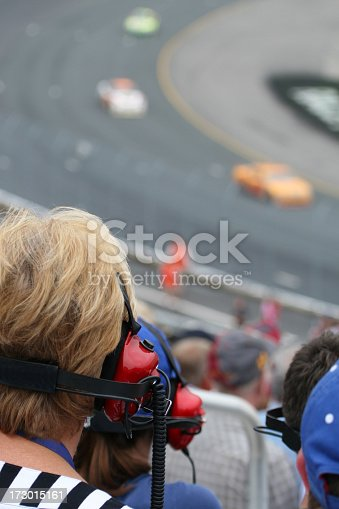 173015172 istock photo Senior Woman Fan at Racing Event and Looking at Race 173015161